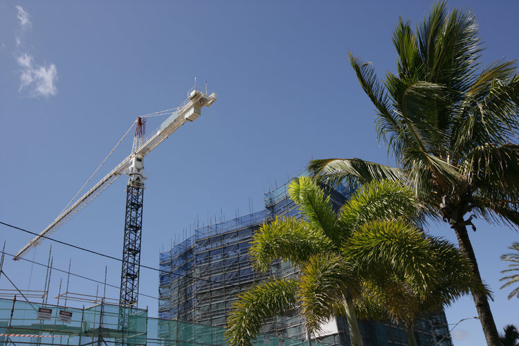 Crane building large apartment building