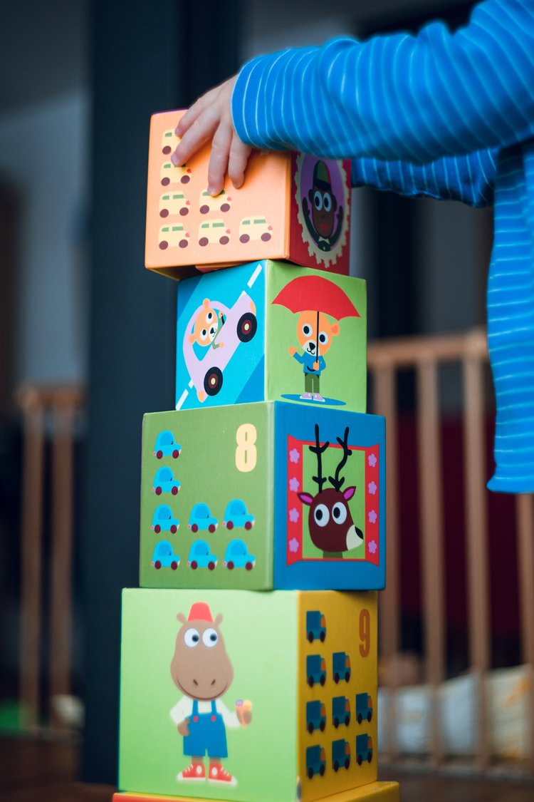 Child stacking toy boxes